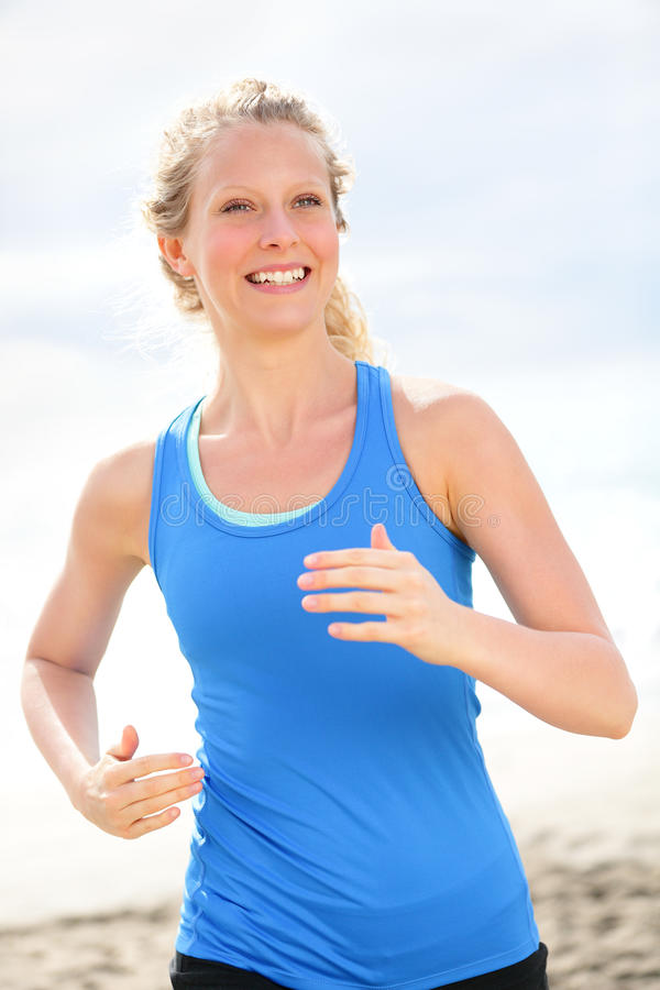 Exercising young woman running and jogging happy stock images