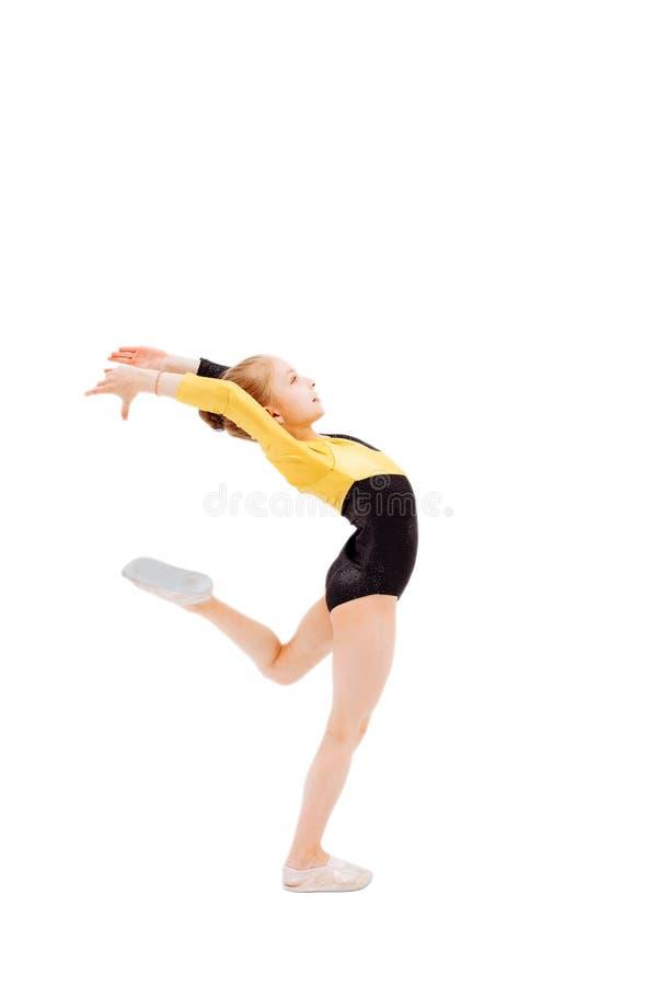 Exercitador flexível da menina bonita no estúdio Ação, beleza imagens de stock