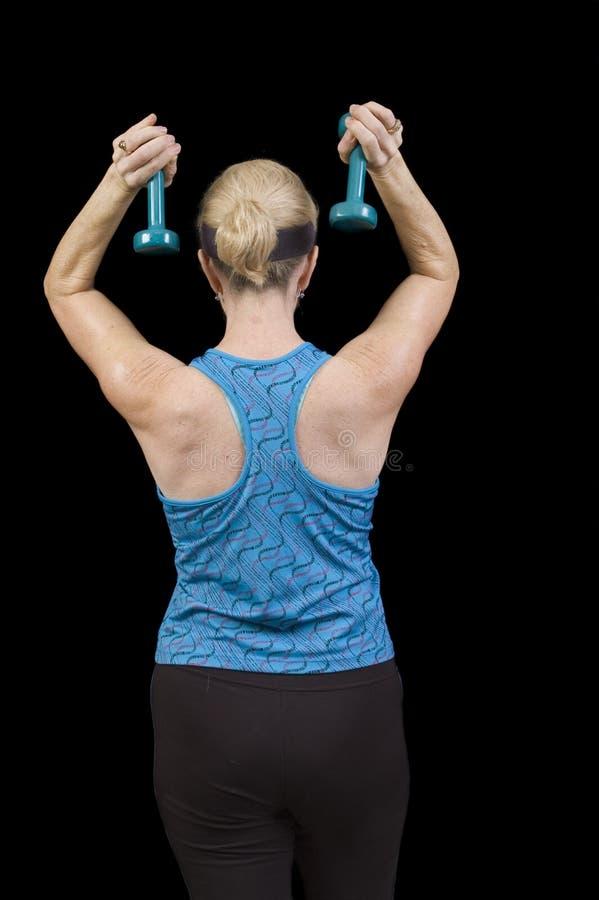 Exercitando a mulher imagem de stock