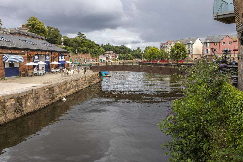 Exeter Quay in Devon. Exeter, UK - July 31st 2019: A view of the River Exe from Exeter Quayside in the city of Exeter in Devon, UK royalty free stock images
