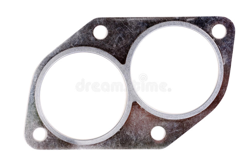 Exhaust manifold gasket for an automobile. Automotive steel gasket for the exhaust system (intake pipe) isolated on white stock photos