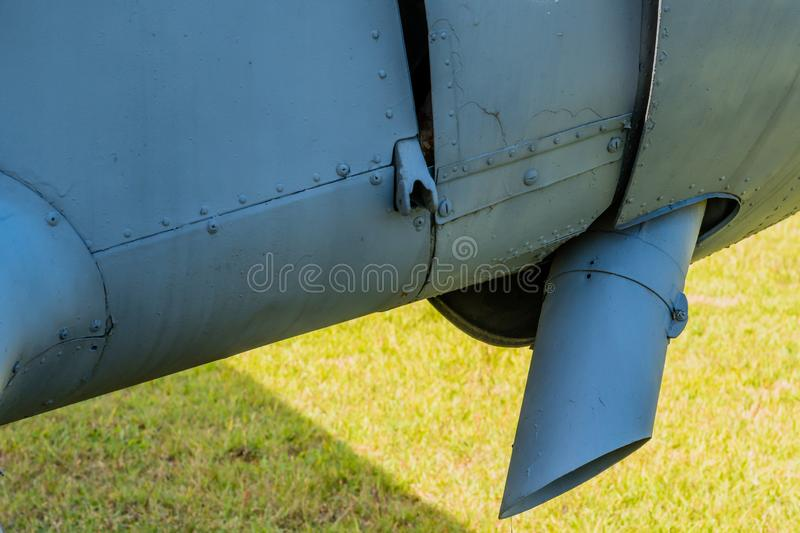 Exhaust pipe of antique airplane. Exhaust pipe protruding out from engine cowling of antique airplane on display in public park stock photos