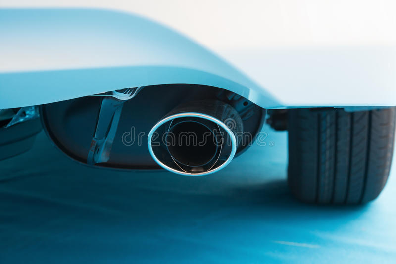 Exhaust pipe of a white car stock photos