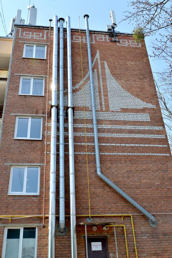 Exhaust pipes on house facade. The local gas boiler house on the first floor of the building. Kaliningrad.  royalty free stock photography