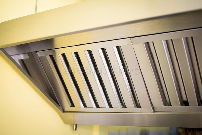 Exhaust systems, hood filters detail in a professional kitchen. stock image