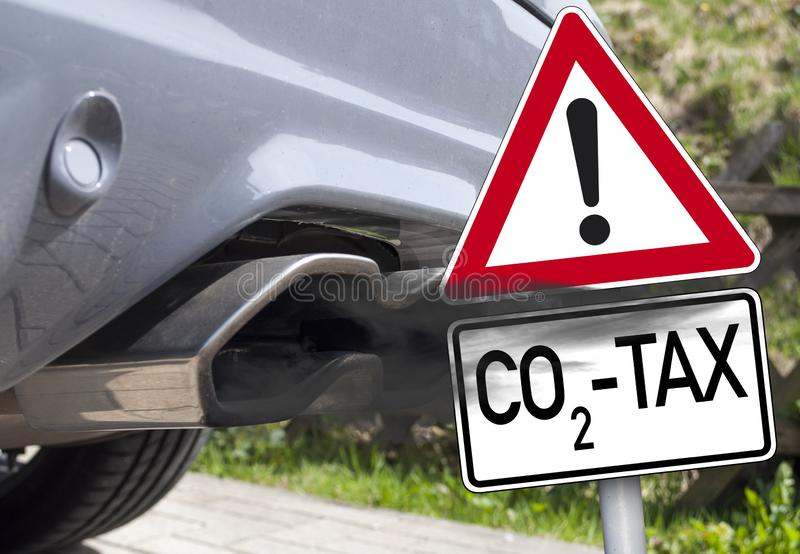 Exhaust with traffic sign CO2 Tax stock image