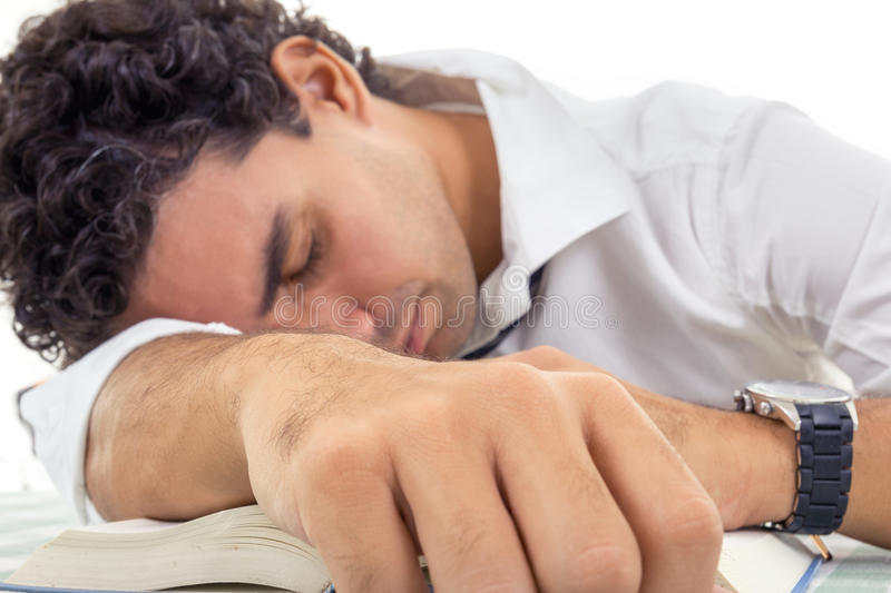 Exhausted adult man with glasses in white shirt and tie sitting royalty free stock image