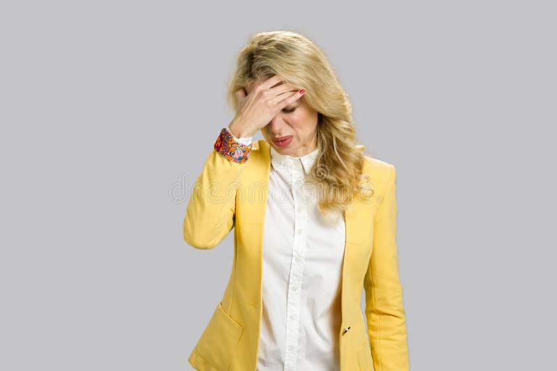 Exhausted blond woman having headache. royalty free stock photos