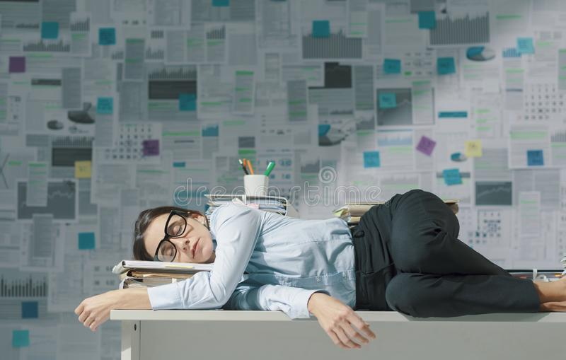 Exhausted business executive sleeping in the office stock image