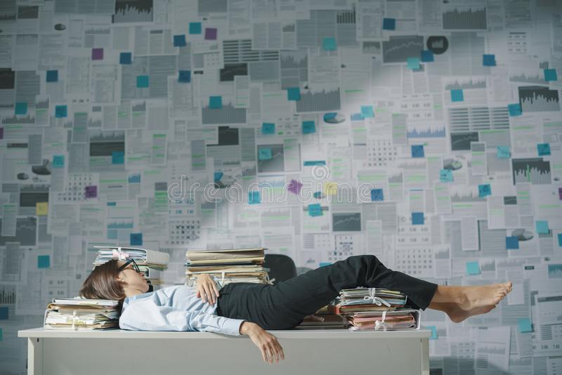Exhausted business executive sleeping in the office royalty free stock photos