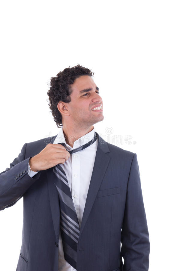 Exhausted businessman removing tie. Exhausted businessman in suit removing tie stock images
