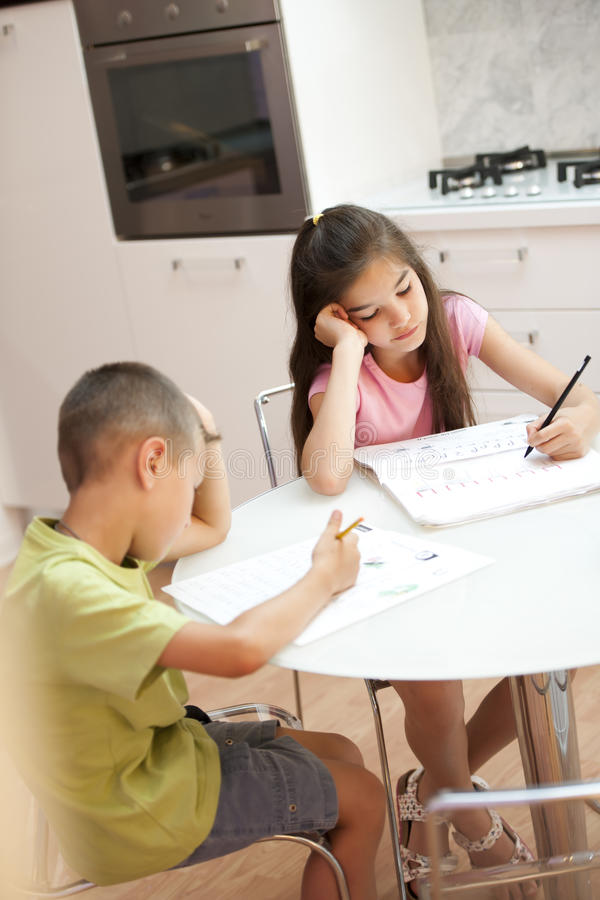 Exhausted children studying royalty free stock image