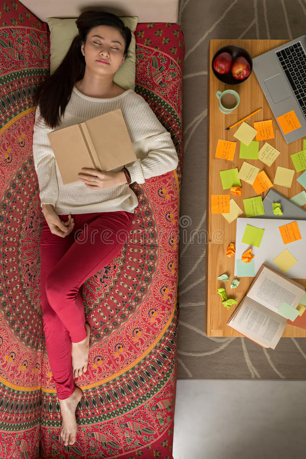 Exhausted college girl stock photo