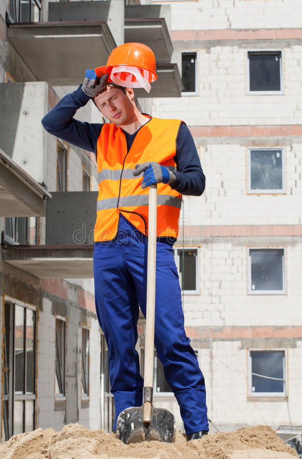 Exhausted construction worker stock photos