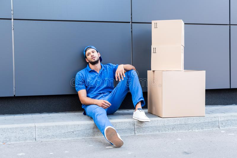 Exhausted delivery man stock photos