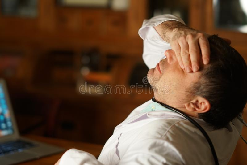 Exhausted doctor stock image
