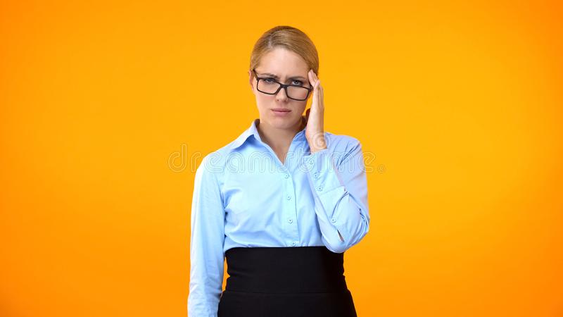 Exhausted female employee suffering stress, workload headache, health care stock photography