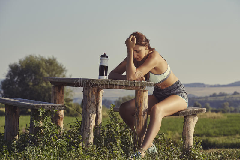Exhausted female runner royalty free stock image