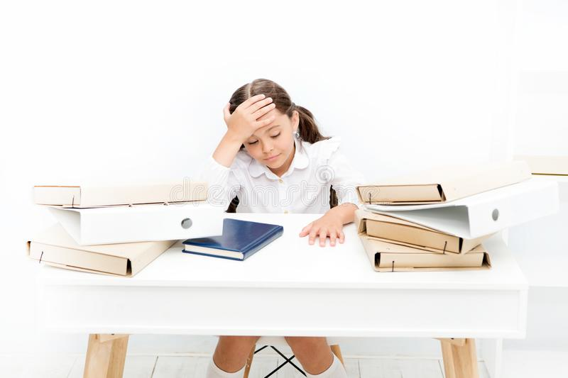 Exhausted girl with workbook and folders. Education. boring lesson. Towards knowledge. small girl on lesson. homework. And home schooling. kid learn and study stock photos