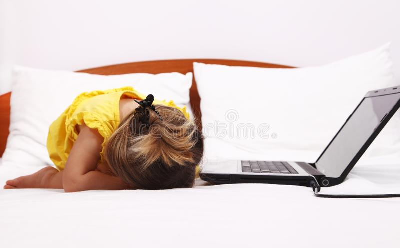 Download Exhausted Kid Who Sleep Near A Laptop Stock Photo - Image: 26259378