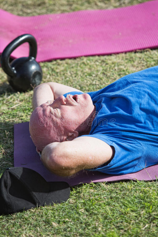 Exhausted Man Exercising royalty free stock photos