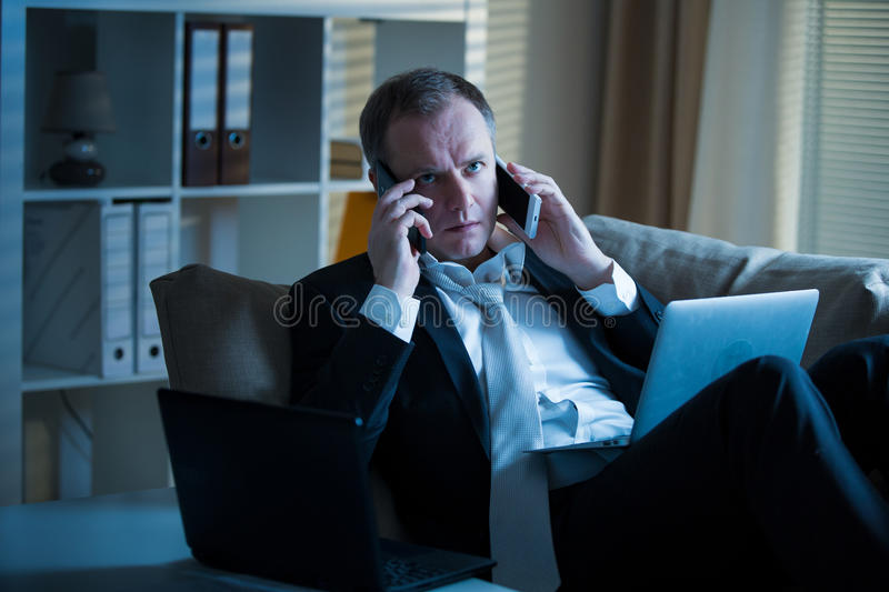Exhausted man in office stock images