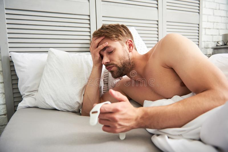 Exhausted man waking up at home royalty free stock photo