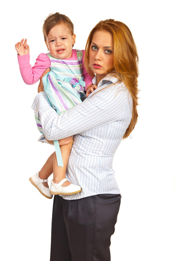 Exhausted mother and crying girl stock photo