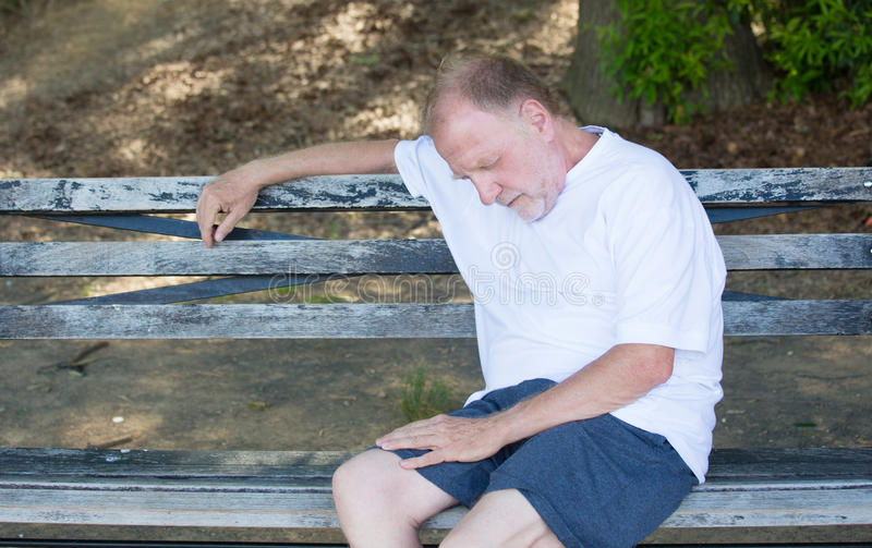 Exhausted old man royalty free stock photo