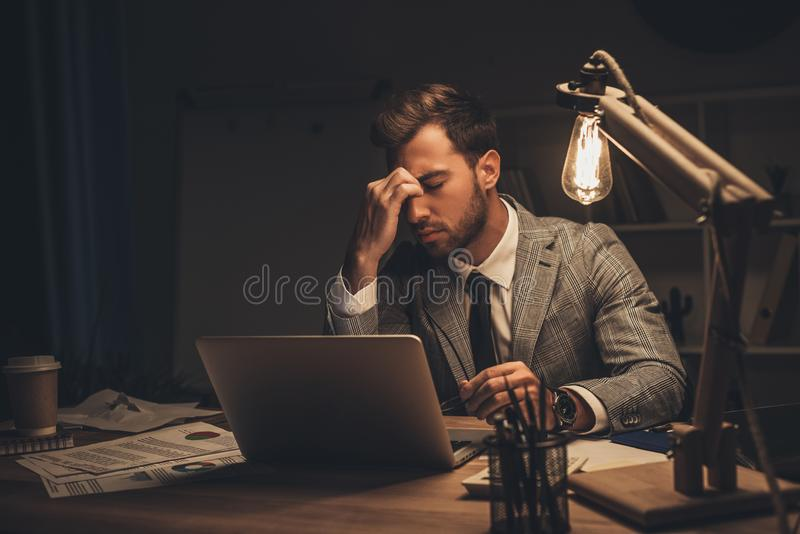exhausted overworked businessman working royalty free stock photo