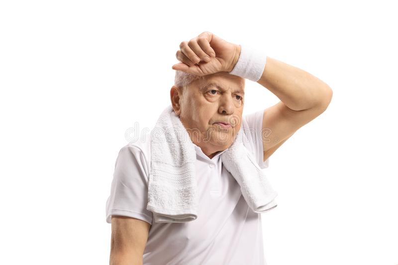 Exhausted senior on a holding arm on his forhead royalty free stock photos