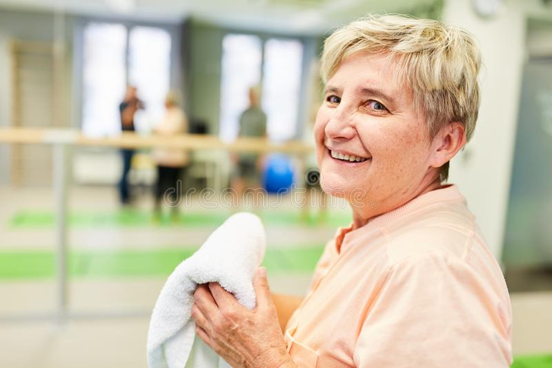 Exhausted senior woman in a break at the fitness center stock images