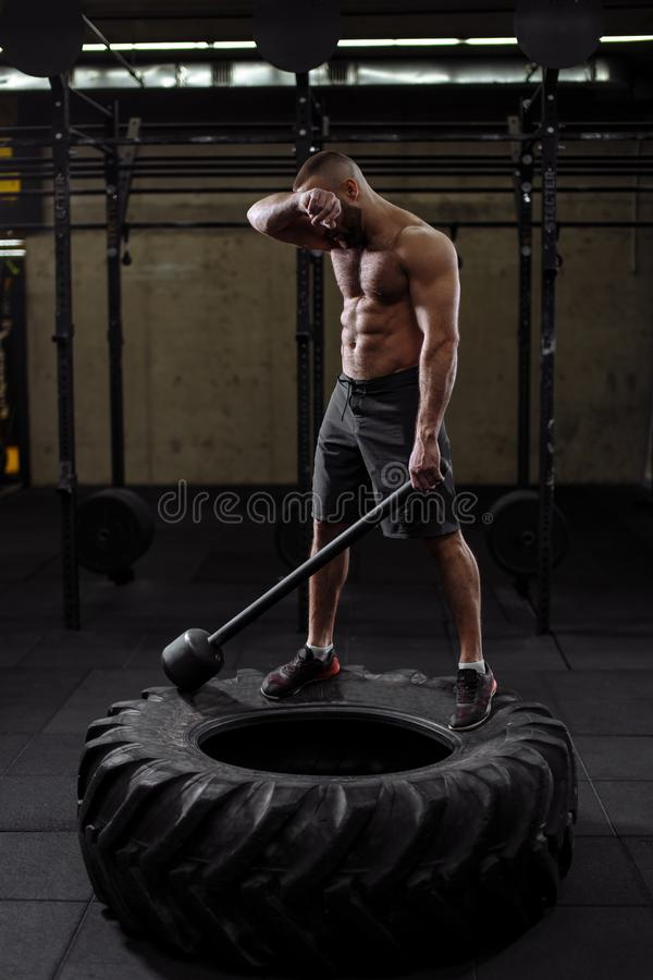 Exhausted sportsman is mopping his brow after hard training royalty free stock photo