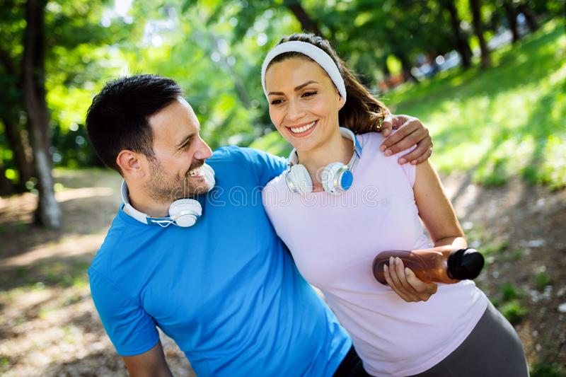 Exhausted fit couple runners after fitness running workout outdoors royalty free stock photography