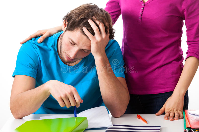 Exhausted student supported by friend stock photography