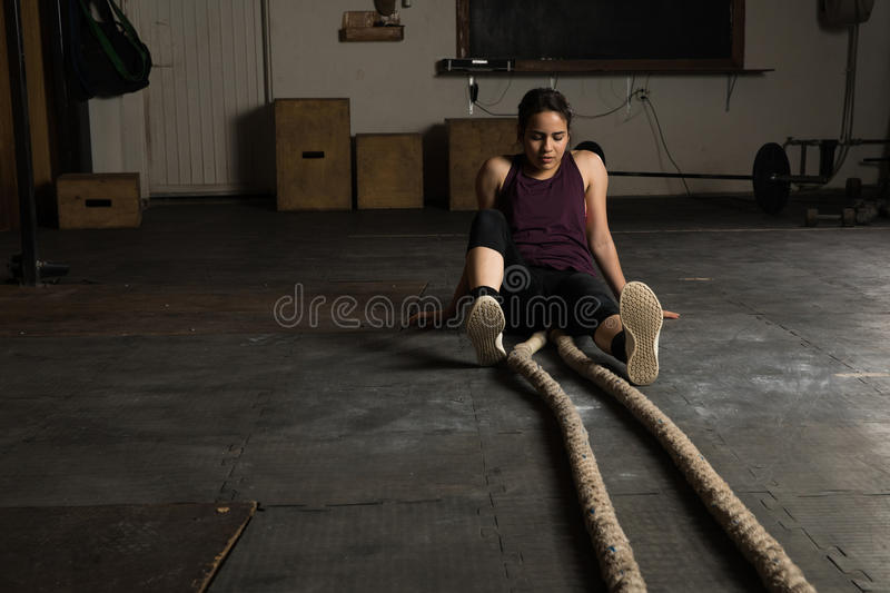 Exhausted woman in a cross-training gym stock photo