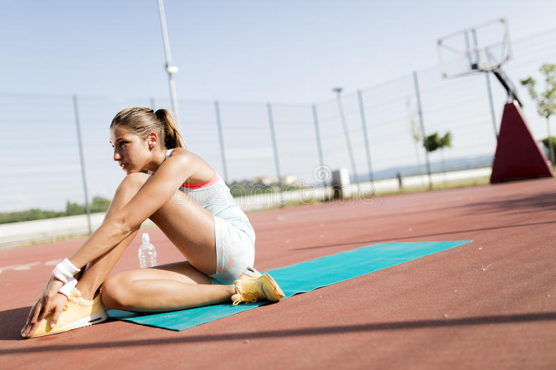 Exhausted young beautiful woman taking a break royalty free stock photo