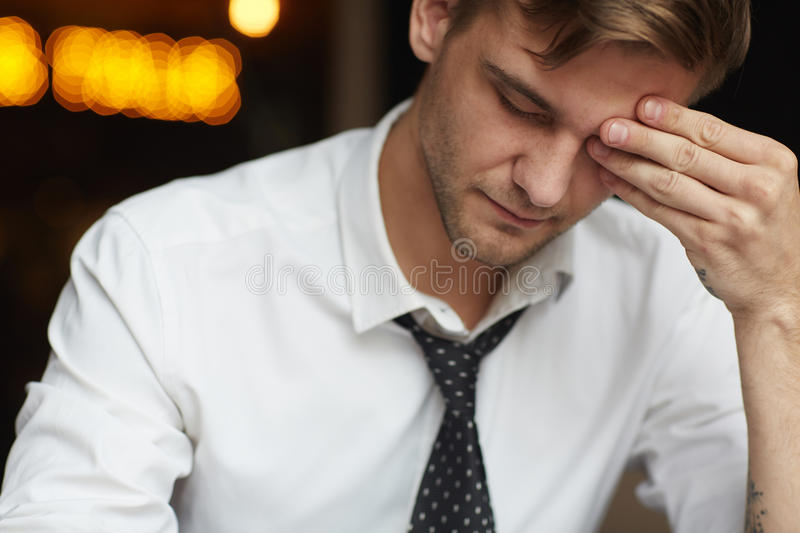 Exhausted Young Businessman stock photos
