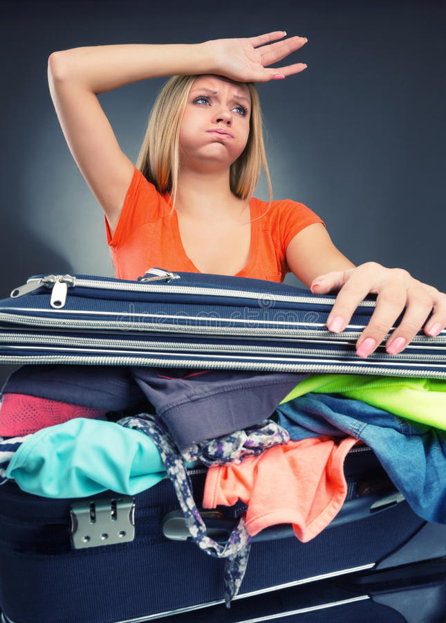 Download Exhausted Young Woman Packing Luggage Stock Image - Image: 34532907
