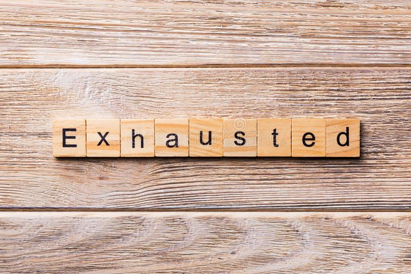Exhaustion word written on wood block. Exhaustion text on wooden table for your desing, concept.  royalty free stock photo