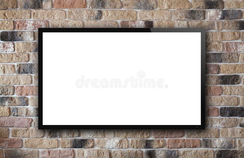 Exhibición de la TV en la pared de ladrillo fotografía de archivo