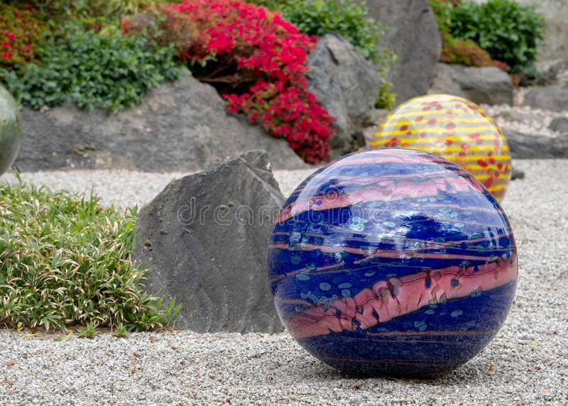 Exhibit entitled `Niijima Floats` by glass artist Dale Chihuly at Kew Gardens, London UK. royalty free stock photography