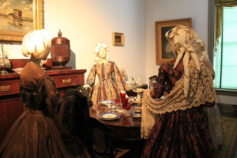 Exhibit of mannequins in period dress, gathered in area of music room,Canfield Casino,Saratoga Springs,New York,2016. Large exhibit of female mannequins dressed stock image