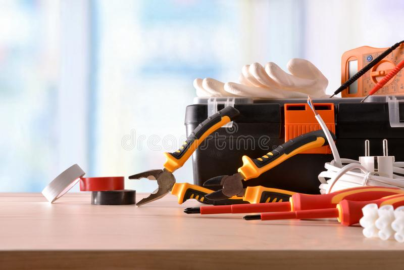 Exhibition of electrical material on wood table with window background. Horizontal composition. Front view stock photos