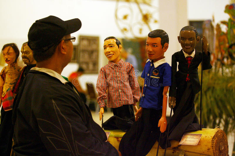 Exhibition of puppets. Visitors saw the exhibition of puppets in the city of Solo, Central Java, Indonesia stock photos