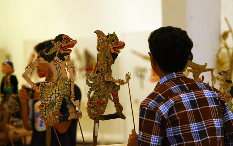 Exhibition of puppets. Visitors saw the exhibition of puppets in the city of Solo, Central Java, Indonesia royalty free stock image