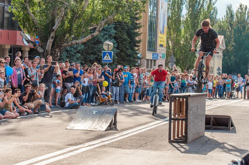 An exhibition show in the central city square of an acrobat bicyclist dedicated to the Day of Youth. stock photo