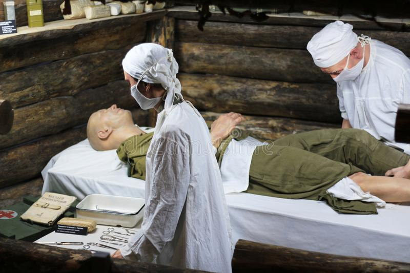 Exhibits of military doctors providing medical care stock images