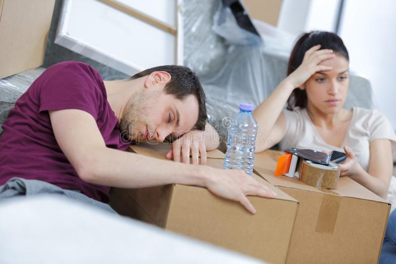 Exhusted couple from moving house royalty free stock photo