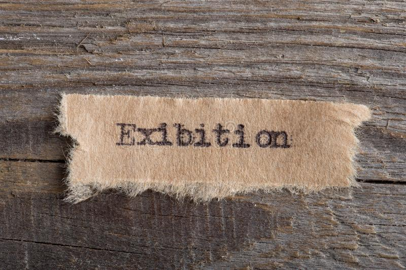 Exibition word on a piece of paper close up, business creative motivation concept. Exibition - word on a piece of paper close up, business creative motivation royalty free stock image